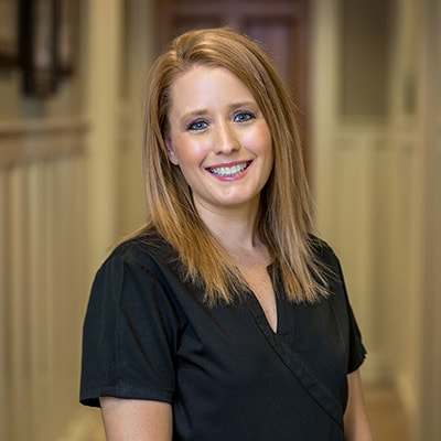 Alisha, one of our certified dental assistants in her black uniform