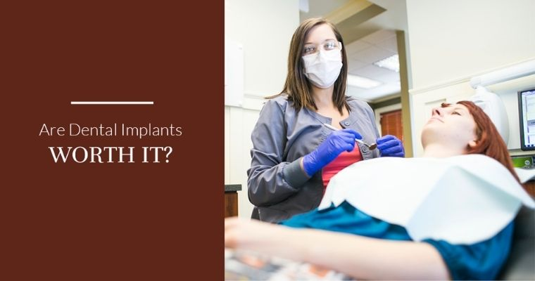 Dental assistant working with patient