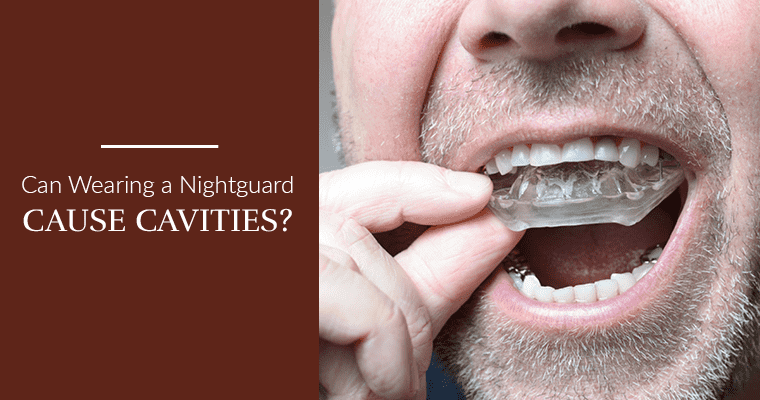 Can wearing a night guard case cavities? Man putting in a clear nightguard